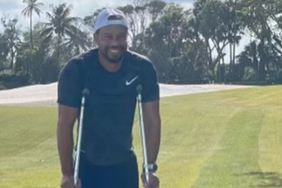Tiger Woods posts photo of himself using crutches weeks after horrific crash.