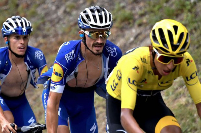 Tadej Pogacar wins stage 15 in sprint finish with overall leader Primoz Roglic.