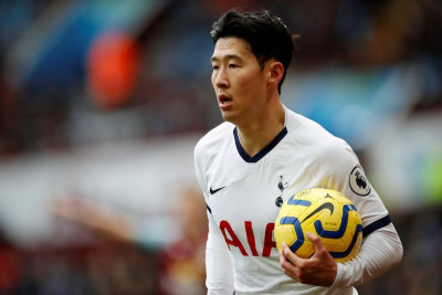 Son and Kane send Spurs top as Partey suffers another injury.