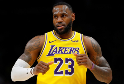 Los Angeles Lakers star LeBron James injures ankle in defeat by Atlanta Hawks.